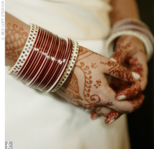 Laurie wore the traditional churrah bracelets for her ceremony. She also had her hands, wrists, and feet decorated with mehendi.