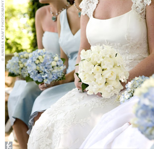 Melissa chose a classic combination of creamy flowers. Her bouquet had lush ivory roses and pearl-studded stephanotis.