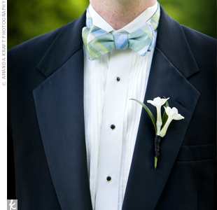 Adding a little pizzazz to his simple black tuxedo, Robert accessorized his look with a green and blue plaid bow tie.