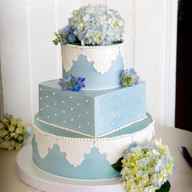 The blue buttercream cake with fondant lace detailing was made to match the bridesmaid dresses. Hydrangeas crowned the top.