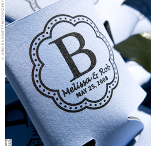 How practical! Guests took home drink koozies personalized with the couple's monogram.