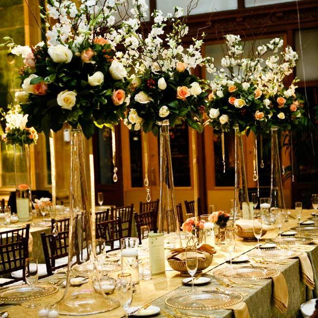While the reception was flooded with mint and gold details matching Aishah's outfit, the couple wanted even more color. They chose peach roses and white orchids for the centerpieces. Adding texture to the room, some tables had tall arrangements and the others had a mix of tall and short arrangements with ivory candles.