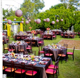 Round, square, and rectangular tables covered in chocolate linens and surrounded by chiavari chairs with burnt orange covers transformed the outdoor garden. Chocolate paper lanterns strung above defined the space and added a rich glow once the sun went down.
