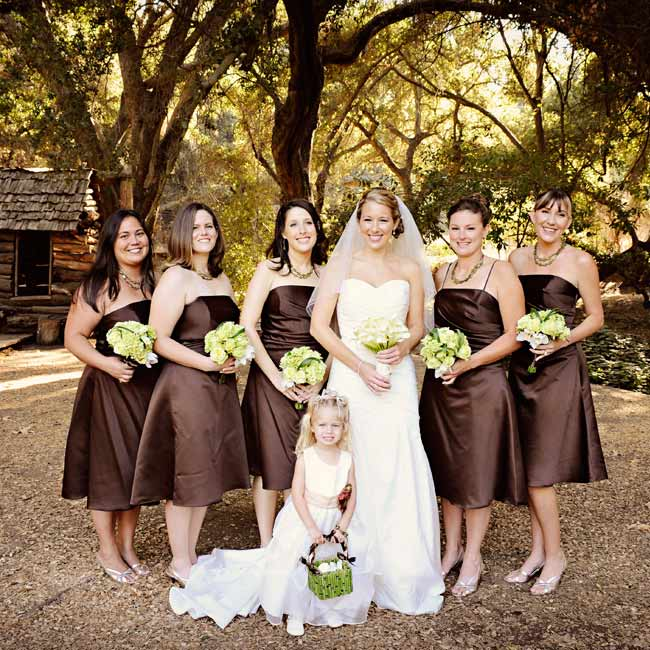 Field-fresh bouquets inspired by the ranch setting coordinated with the bridesmaids' naturally elegant chocolate brown dresses.