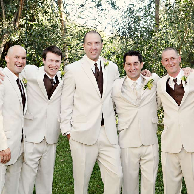 The groomsmen wore ivory suits with chocolate vests and ties, while the groom wore muted ivory accessories.