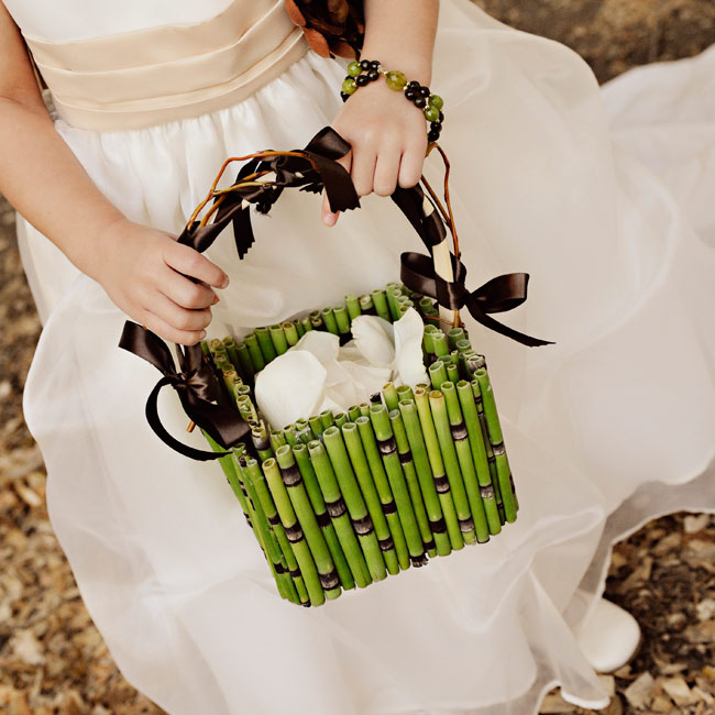 Dressed in an ivory, ankle-length dress, the flower girl carried a rustic basket lined with equisetum and filled with rose petals.