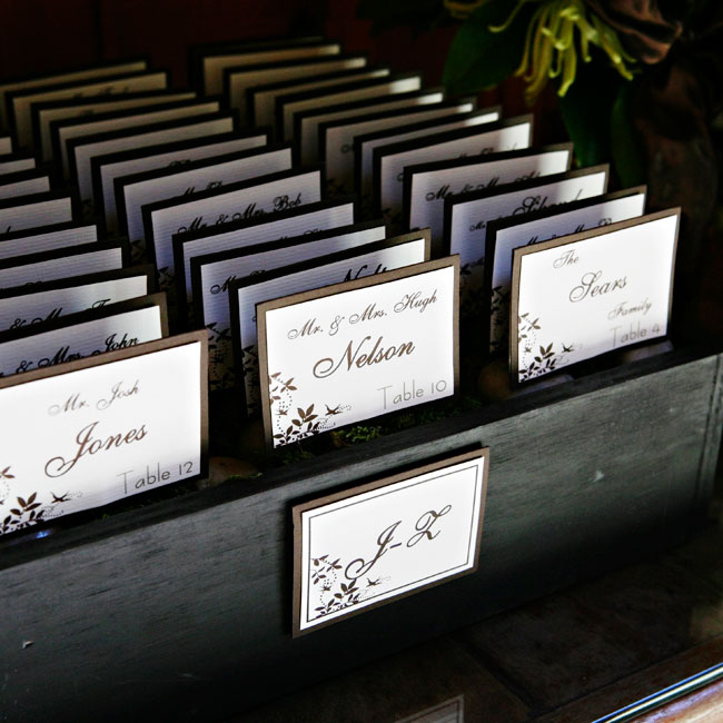 Green moss-filled boxes held the escort cards. The boxes were divided by letter of the alphabet so guests could easily find their seat assignments.