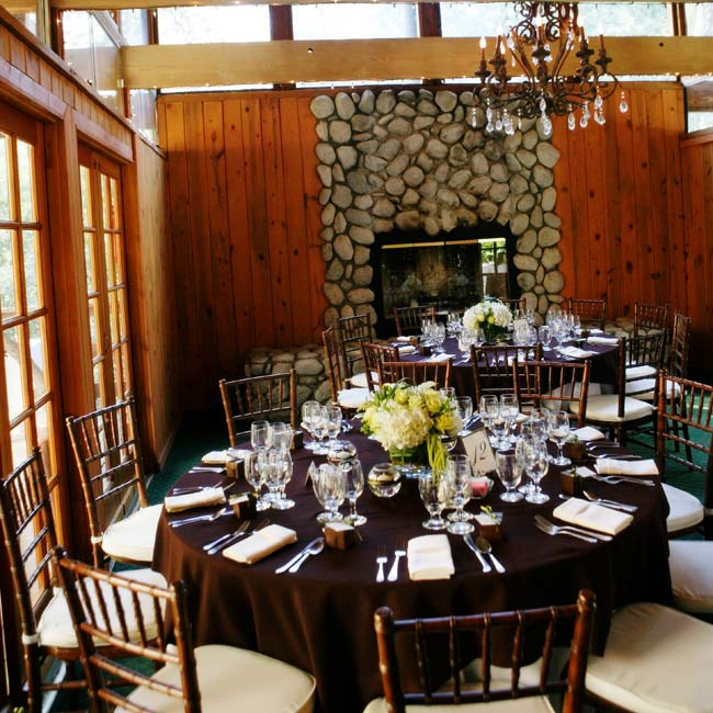 Chocolate brown linens topped with green centerpieces tied in with the rustic feel of the ranch's ballroom.