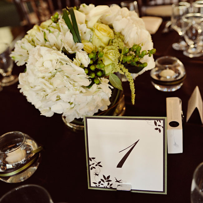 Simple script table numbers incorporated the chocolate brown leaf design.