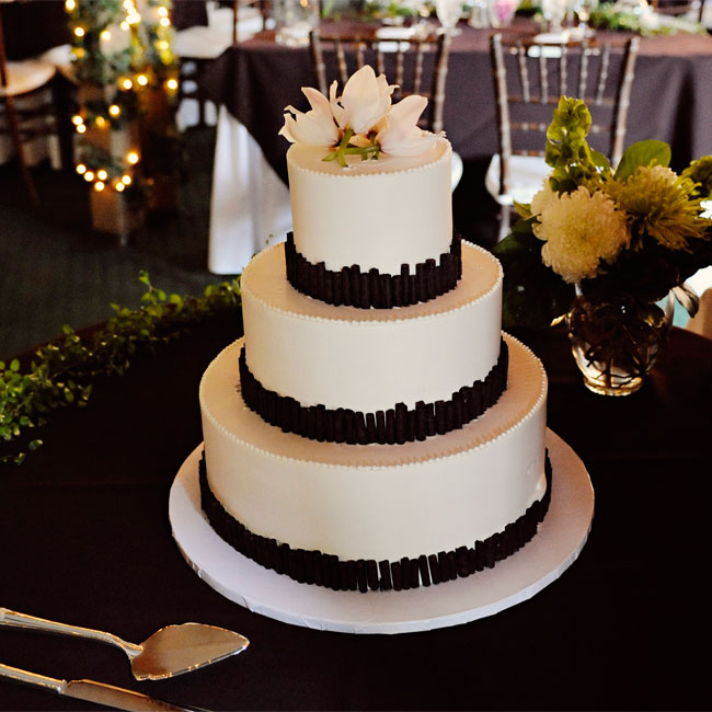 Hand-cut chocolate, rolled to resemble bamboo, lined the three layers of the dessert. White blooms topped it off.