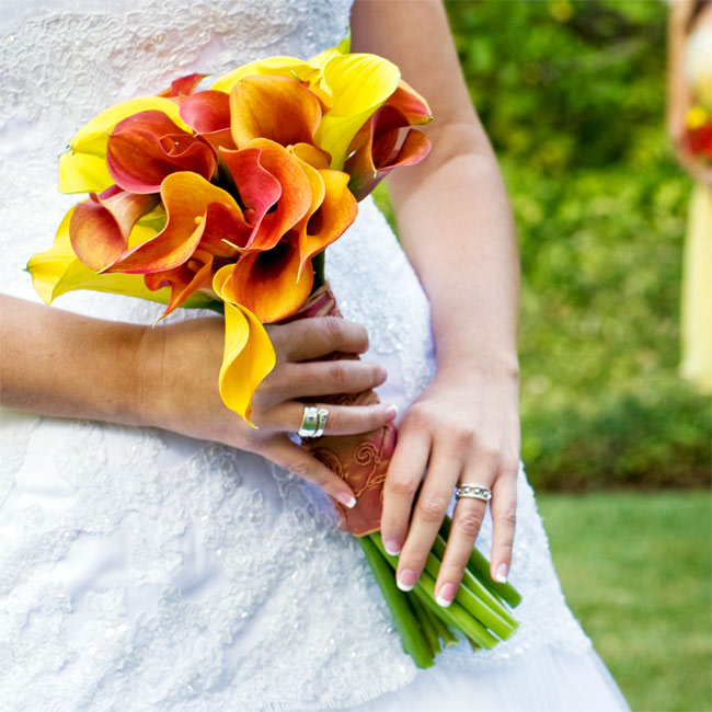 Calla lilies in yellow, red and orange added pops of color to the bride's otherwise subdued look.