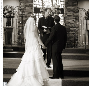 A pastor from the couple's church performed the ceremony in the sunlight-drenched First Congregational Church of Anaheim. The altar arrangements not only fit the color scheme; they also matched the stained glass windows.