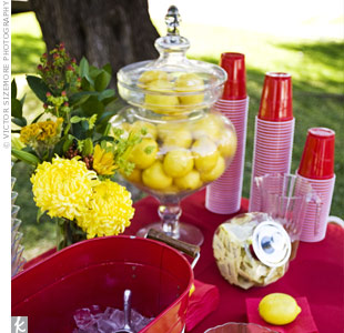 Yellow and red blooms and an apothecary jar stuffed with lemons dressed up the drink display, where guests could choose from iced tea and lemonade.