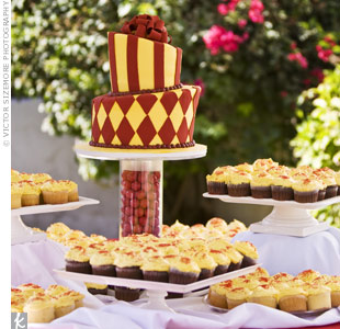 The carnival wedding called for a topsy-turvy cake with bold patterns in the signature hues. For extra color, the acrylic cake stand was filled with red gumballs.