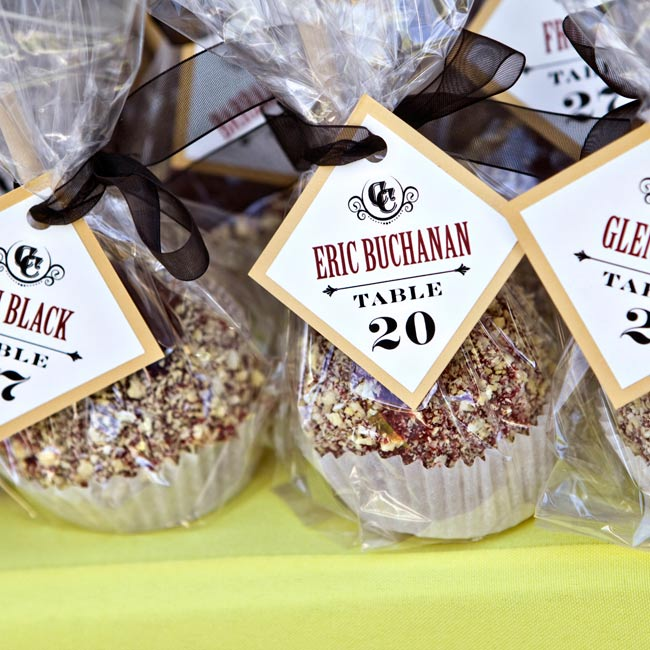 How sweet! Guests found their seating assignments from tags attached to candy apples.