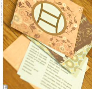 Another one of Danielle's DIY projects, four versions of aqua, orange, brown and gold patterned papers topped with a Gemini symbol detailed the ceremony.