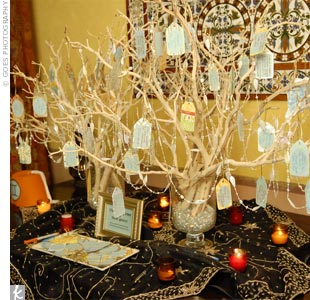 In lieu of a guest book, guests wrote wishes for the couple on paper tags, made from the same paper used for the programs, and hung them from a tabletop tree strung with glass beads.