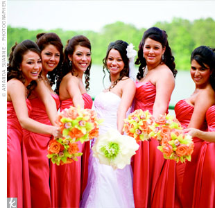 The draping of the bridesmaids' dresses mimicked the bride's gown's style for a cohesive bridal party look.