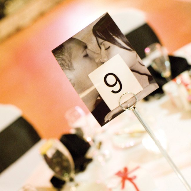To add personal flair to the reception, the couple superimposed numbers over photos of them to mark the tables.