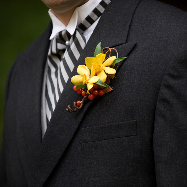 The groom's and groomsmen's black, white and gray outfits got a punch of color from an orchid-and berry boutonniere. Fiddlehead fern spiraled out from the bottom to give the bouts a playful edge.