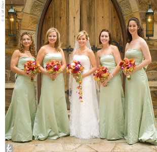 Small trains added even more elegance to the already refined Vera Wang bridesmaid gowns. The brightly colored bouquets popped against the strapless, sage dresses.