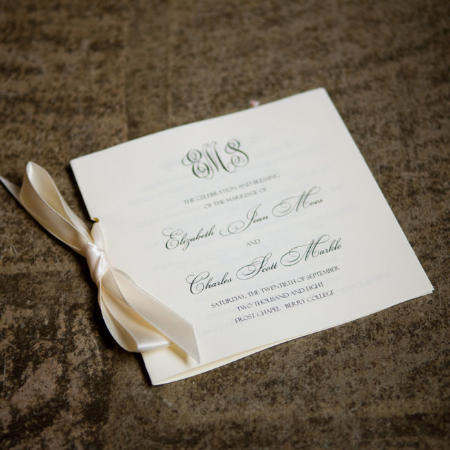 Script fonts and an ivory, satin ribbon lent formal flair to the simple booklets.