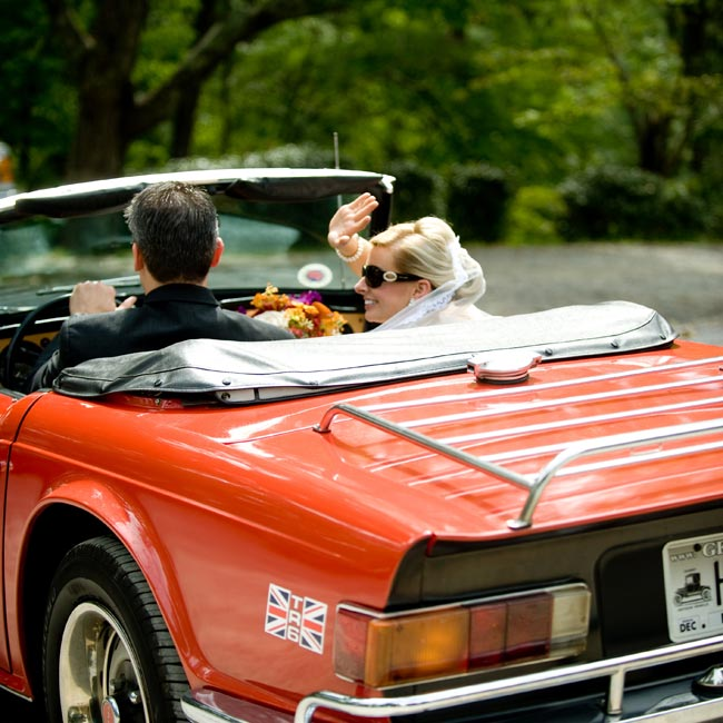 Elizabeth and Scott drove off into the sunset in Scott's brother's vintage '60s Triumph.