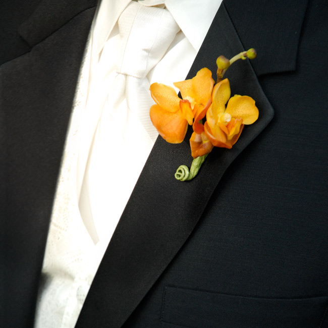 "Keith donned a ""Buffalo Orange"" orchid on his lapel."
