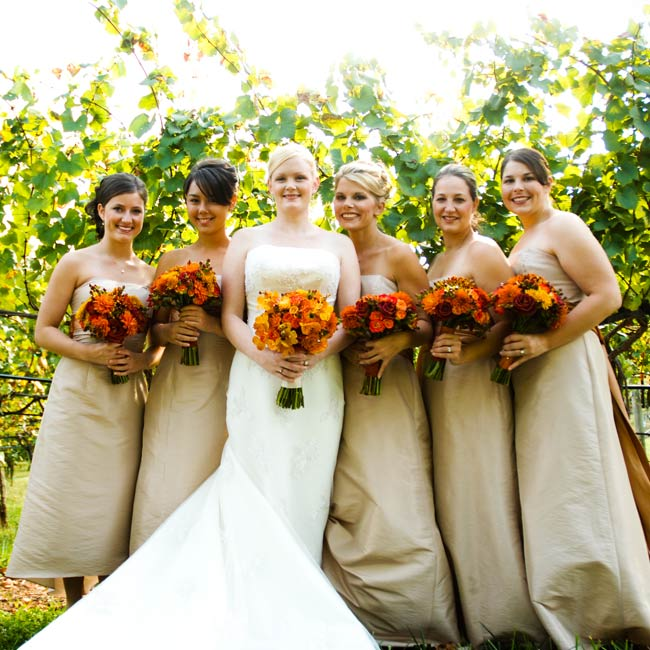 A burnt-orange sash added a burst of color to each maid's champagne-colored taffeta dress.