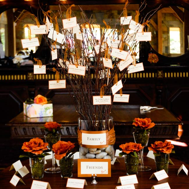 There were two escort card displays. One, the family tree had all of the relatives' cards, while the guests' cards were lined up on the table.