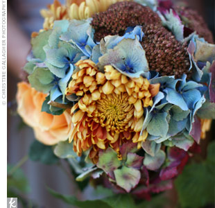 Antique hydrangeas, sedum, roses and other blooms brought the perfect fall-inspired feeling to the bridesmaid bouquets.