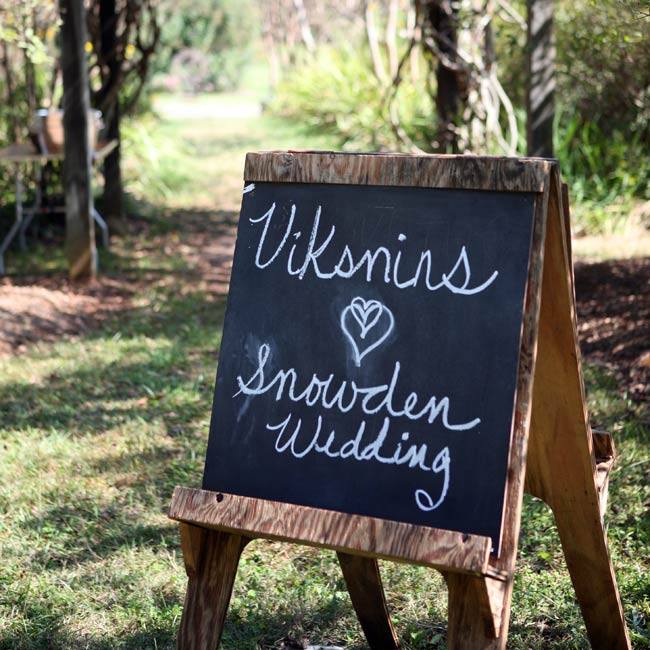 A chalkboard with the couple's last names marked the ceremony site.