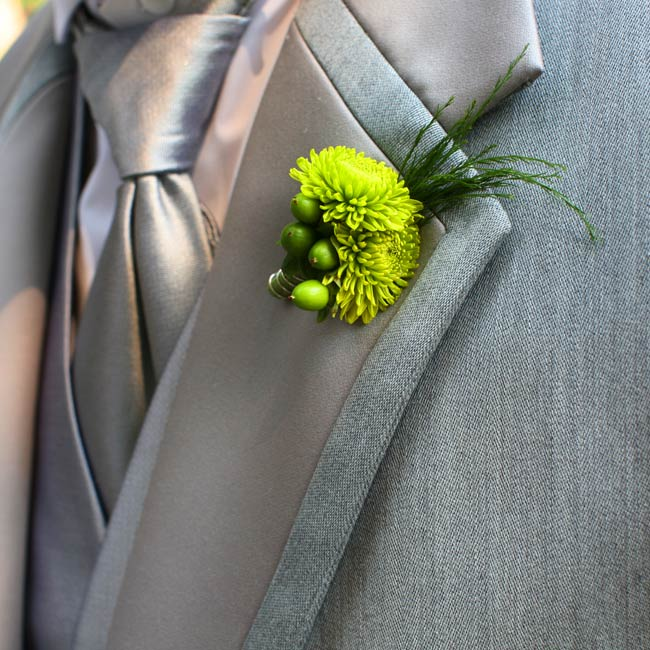 Green mums and hypericum berries tied in the wedding colors.