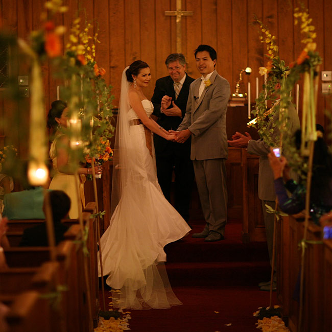 "Victoria and Steven a said ""I do"" in a traditional ceremony at the nearly sixty-year-old Log Cabin Church in Smyrna."