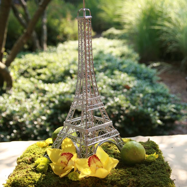 Instead of a guest book, partygoers signed a coffee table book filled with the sites of Paris -- one of their honeymoon destinations. A wire Eiffel Tower on a bed of moss covered with orchids sat next to the book.