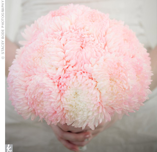 They may look like cotton candy puffs, but Cassi was actually carrying lighter-than-air football mums. The bride chose them for their whimsical look.