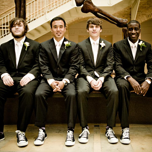 Black Converse Chuck Taylors and skinny pink ties dressed down the guys' traditional suits.