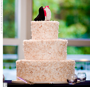 Toasted coconut shavings gave the coconut cake a slight pink tone to match the rest of the decor. The shavings, which stuck out a bit from each layer, gave the cake a playful feel.