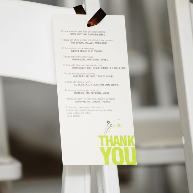 In lieu of ceremony programs, cards printed with a message thanking guests for supporting the couple throughout both their lives and relationship hung from each ceremony chair. The brown ribbon and lime green logo were all the sprucing up the chairs needed.