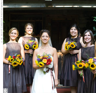 Orange ribbon belts gave a pop of color to the bridesmaids&#39; dark, tea-length dresses. A hidden surprise: pockets for holding lipstick for touch-ups!