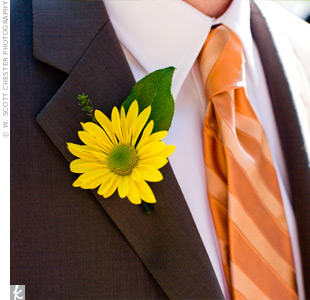 A single, yellow gerbera decorated the groom&#39;s lapel adding a burst of color to his neutral-toned suit. &quot;My bridesmaid, Kate, spontaneously made this and the groomsmen&#39;s boutonnieres!&quot; says Allyson.