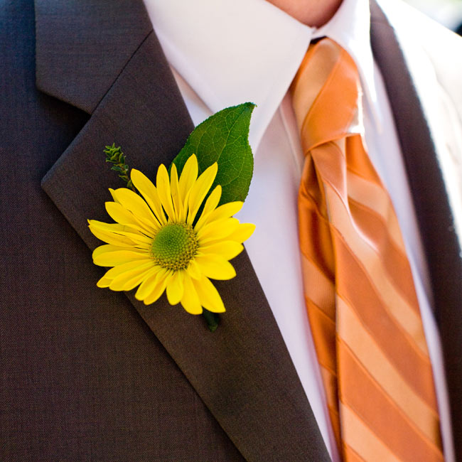 "A single, yellow gerbera decorated the groom's lapel adding a burst of color to his neutral-toned suit. ""My bridesmaid, Kate, spontaneously made this and the groomsmen's boutonnieres!"" says Allyson."