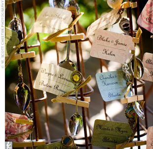 Keeping the escort cards from blowing away at the outdoor wedding was a challenge, but the couple was up for the task. Clothespins fastened antique spoons from the bride&#39;s personal collection and tags with guests&#39; names and table assignments tied to a vintage Coca-Cola bottle stand. Why Coke? &quot;Their headquarters are in Atlanta, and Pearces family  ...