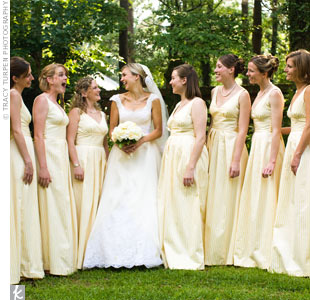 """I couldn't find a yellow bridesmaid dress I liked, so I had the same seamstress who altered my gown, create the bridesmaids' dresses,"" says Emily. The yellow-and-white stripes were a perfect fit for the garden party, while the silk material and floor length made the dresses formal enough for a black-tie affair."