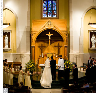 The couple got married at St. Mary, the same church Emily attended while growing up. They exchanged vows in a traditional Catholic wedding.