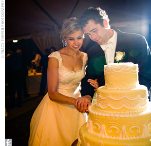 Emily spotted four different cakes she liked while researching for her wedding. Instead of choosing between them, she had her baker use one design for each of the four tiers of the yellow cake. Though the embellishments were traditional, combining four different designs was anything but.