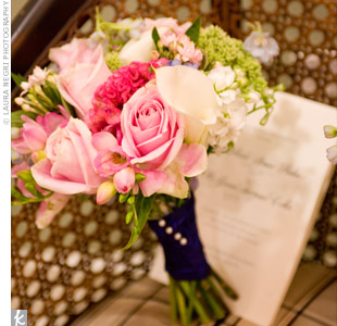 Melissa carried pink, green and white roses, hydrangeas, and berries wrapped in black satin.