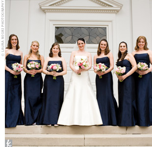 Strapless, A-line, midnight blue Badgley Mischka gowns flattered both tall and short bridesmaids.