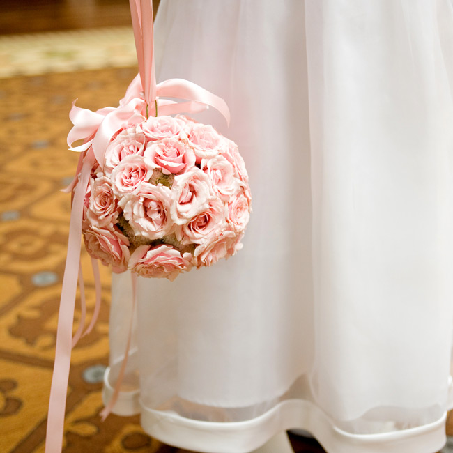 The bride's six-year-old cousin carried a pink rose pomander.