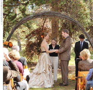 The outdoor ceremony site was perfect with an existing arch made of vines set between two large pine trees.